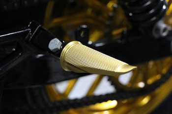 Speed Merchant Gold Anodized peg installed on Harley Dyna