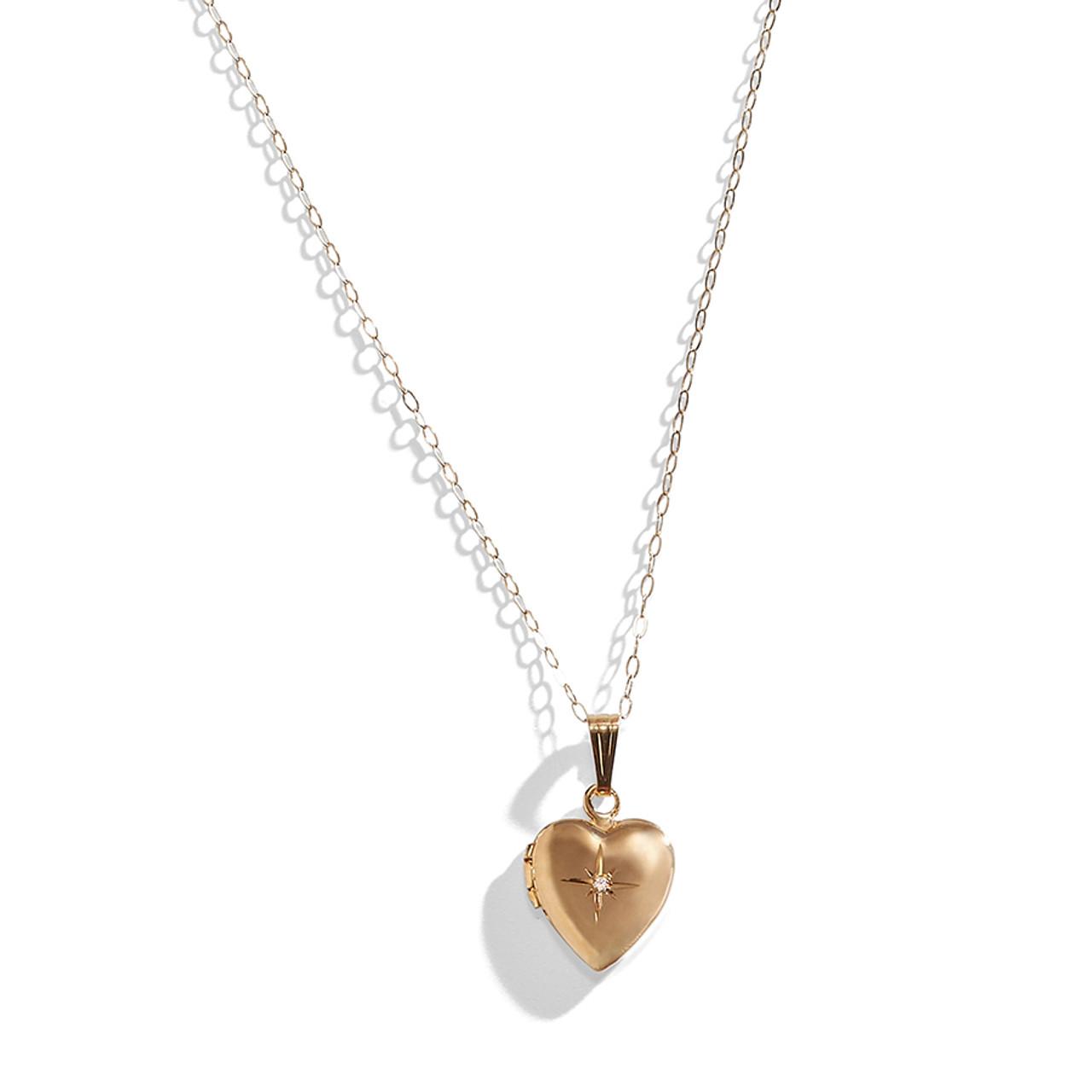 52fc34b4d 14K Gold Secret Heart Locket with Diamond Accent.