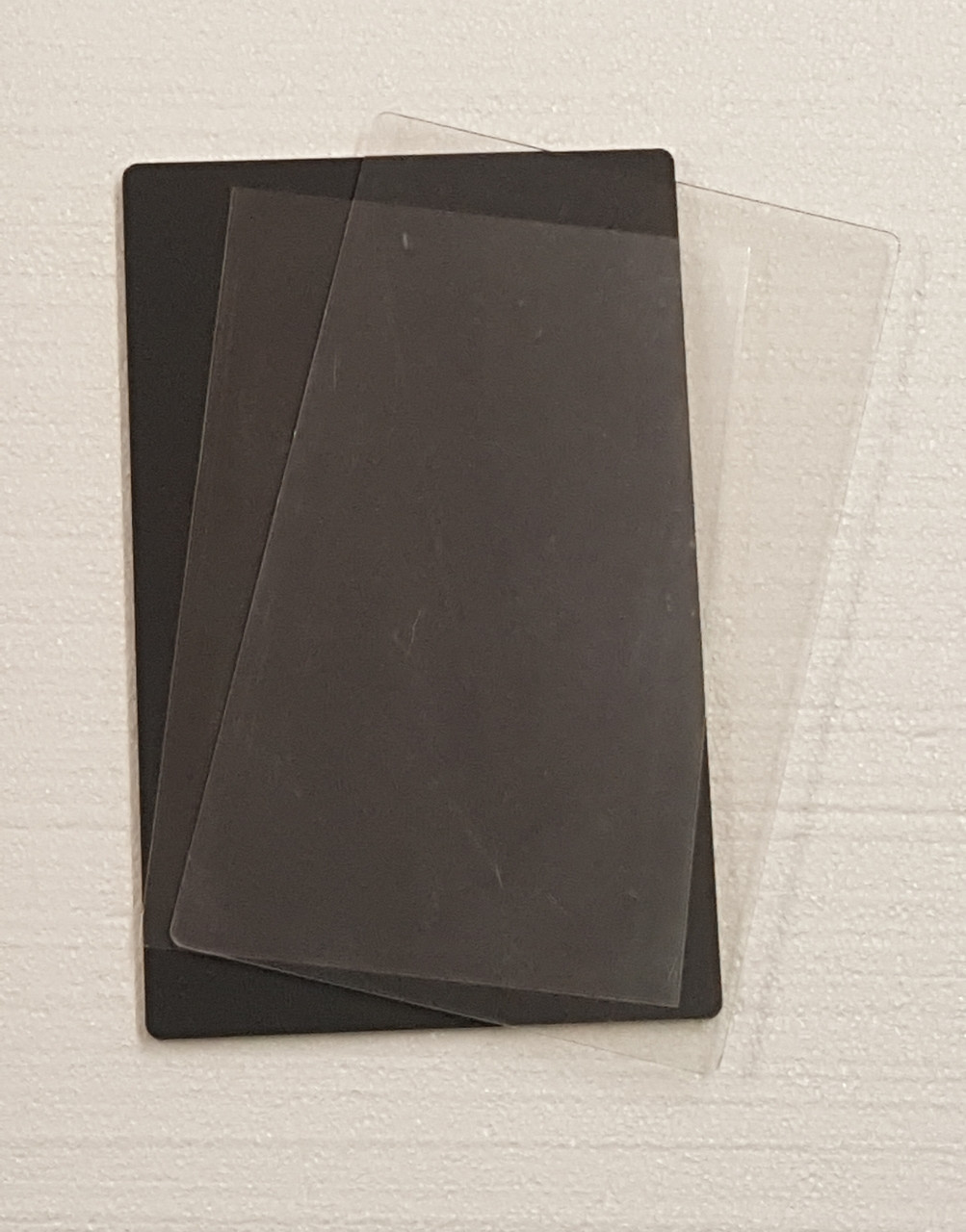 Acrylic front black backer board and Mylar sleeve all included