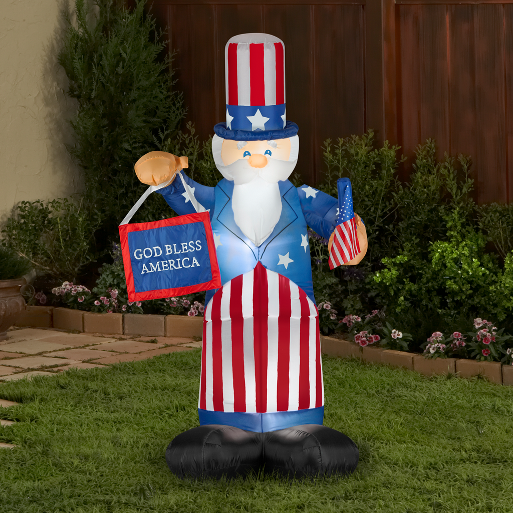 Airblown Inflatable Uncle Sam with Banner in yard.
