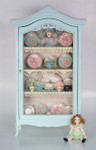 Chintz decals shown in a 1 inch scale cabinet.
