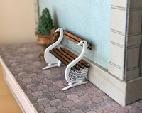 1:48 quarter scale swan bench kit shown on the exterior of Joie de Vivre Bookshop.