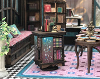 1:48 quarter revolving bookcase shown with bookends in the Joie de Vivre Bookshop.