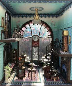 The demilune table is shown on the top balcony of Joie de Vivre Bookshop.