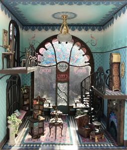 The window seat is shown in the quarter scale Joie de Vivre bookshop.
