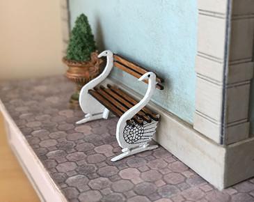 1:48 quarter scale swan bench kit shown on the exterior of Joie de Vivre Bookshop.