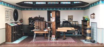 The long worktable kit is shown in the quarter scale printery in Joie de Vivre Bookshop.