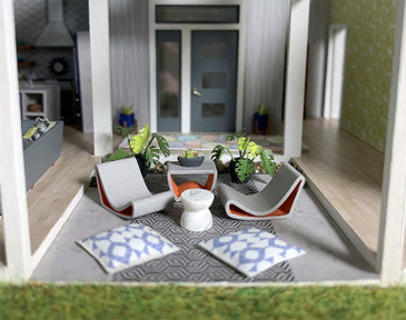 Quarter scale table and chairs for a mid-century modern miniature scene.