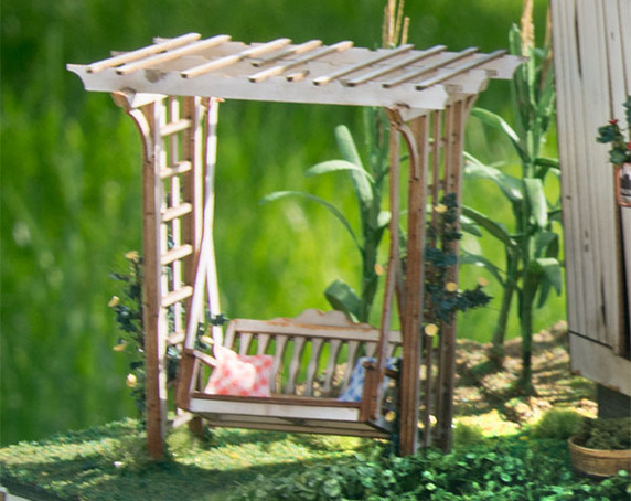 quarter scale arbor with swing, shown weathered next to A Bushel and a Peck kit.