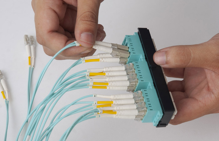 Fiber patch cables installed in ordered sequence into the bezel