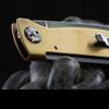 Close Up Of Boker Plus Atlas Brass Folding Knife