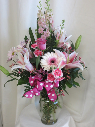 """Sassy Cassy Stargazer Pink Gerbera Bouquet by Enchanted Florist. This all pink bouquet of flowers includes stargazers, of course, as well as roses, gerbera daisy, regular daisy, larkspur and pixie carnations. Approximately 27"""" x 15""""W.   SKU RM136"""
