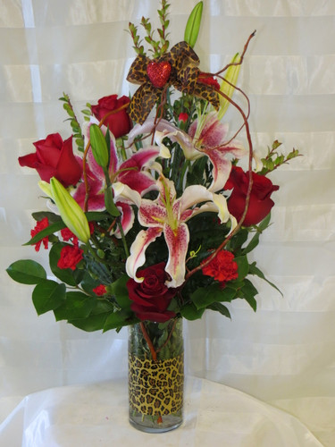 """Jungle Love Red Rose and Stargazer Bouquet from Enchanted Florist - It includes red roses, stargazer lilies and is accented with leopard print straight from the jungle. Approximately 24""""H x 13""""W SKU RM137"""