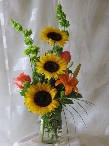 Lemon Drop Sunflower and Orange Rose Flower Bouquet by Enchanted Florist Pasadena TX - Get Well flowers delivered to all Houston area hospitals including all Houston Medical Center hospitals, Bayshore Hospital, Clear Lake Regional, St Lukes Patients, St Johns, and Memorial Southeast Hospital Daily delivery to La Porte TX and Surrounding cities. RM138