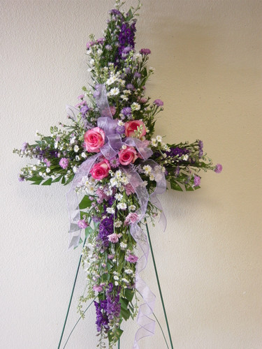 Lavender and Pink Sympathy Cross by Enchanted Florist Pasadena TX - funeral cross of flowers in pinks and lavenders including pink roses, white, lavender, and pink other flowers. Deer Park florist delivers to Deer Park Funeral Directors and Grandview Funeral Home daily.  Perfect for delivery to funeral homes in Pasadena TX. RM501