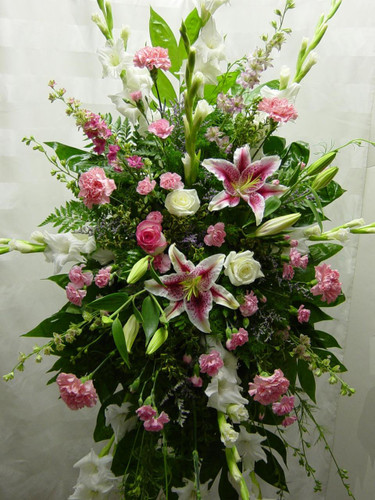 Tribute in Pink Funeral Sympathy Spray by Enchanted Florist - funeral wreath or funeral spray in shades of pinks and whites including stargazer lilies, gladiola, roses, and carnations. Daily delivery to Houston local funeral homes. RM504