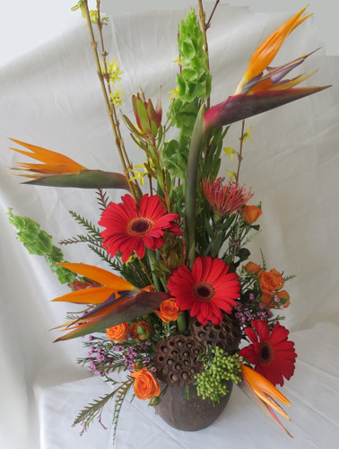 Exotic Escape Tropical Bouquet by Enchanted Florist Pasadena TX. A unique flowers bouquet with tropical flowers including birds of paradise and safari sunset. Same day delivery of tropical flowers in Houston TX. RM165