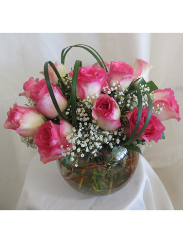 """Delectable Delivery 15 Pink Roses in a Bowl by Enchanted Florist Pasadena TX.  15 pretty variegated hot pink tipped crème roses designed by our talented design team in this 8"""" clear glass rose bowl and accented with tropical foliages and babys breath. Approximately 12""""W x 12""""H SKU RM361"""