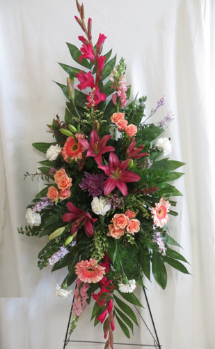 Peaceful Pink Tribute Funeral Spray by Enchanted Florist Pasadena TX. A perfectly pink spray of funeral flowers to include pink gladiolas, peach spray roses, white carnations, pink lilies, pink snapdragons and pink gerbera daisies. RM536