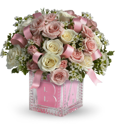 Crystal Block New Baby Girl Flower Bouquet by Enchanted Florist Pasadena TX. Send new baby girl flowers in the adorable keepsake crystal block. Includes miniature white and pink spray roses and ribbons tucked in. Simply stunning for your new bundle of joy! RM305