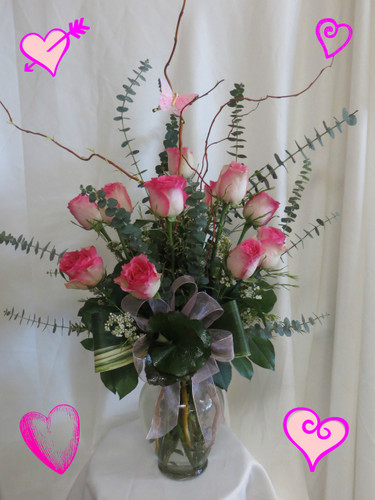 Pink Fire and Ice Premium Dozen Roses by Enchanted Florist in Pasadena TX. Our premium Ecuadorian Malibu roses in an upgraded vase with curly willow, butterfly, and exotic foliages. Malibu is a special bi-colored rose appearing with hot pink tips along creme colored rose petals. Beautiful Valentine roses by the best Deer Park florist. RM906