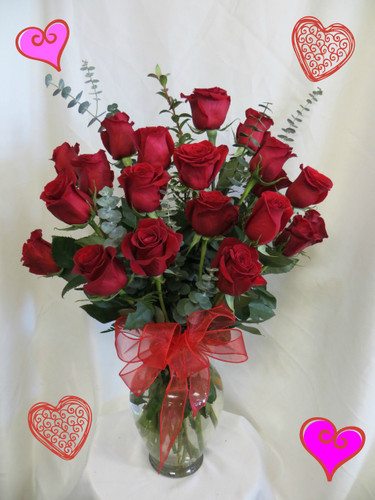 Two Dozen Roses for Valentines Day RED by Enchanted Florist Pasadena TX. This show stopping bouquets of our lush and romantic red roses comes complete with greens and a bow and is hand arranged by our premier floral designers. RM907