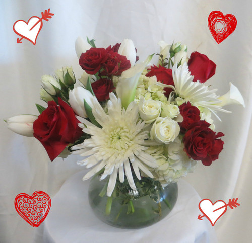 Make Out Bouquet for Valentines Day by Enchanted Florist Pasadena TX. White calla lilies, white spiders, white tulips, white spray roses, red roses and red spray roses. RM925