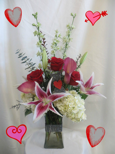 Blushing Love Stargazer Bouquet by Enchanted Florist Pasadena TX. Includes stargazer lilies, red roses, white hydrangeas, and pink mini calla lilies. RM923