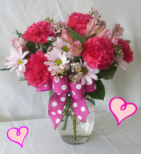 Sweetheart Pink Valentines Day Bouquet by Enchanted Florist Pasadena TX. This Valentines Day Bouquet of flowers includes bright pink carnations, pink daisies, pink alstroemeria lilies, and pink wax flower in a clear glass vase with coordinating ribbons. RM937