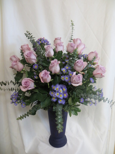 "Midnight Romance 2 Dozen Purple Roses and blow her away. Two dozen beautiful purple roses will surely impress her! When you need a BIG gesture, or just want to spoil her rotten, our two dozen purple roses are THE way to do it.  Includes this high quality upgrade purple vase she can use over and over. This stunning bouquet is over 32"" high and 21"" wide. SKU RM365"