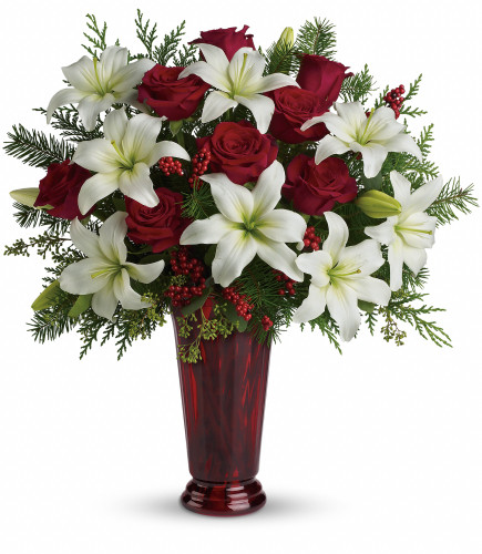 """Holiday Magic Christmas Red Rose Bouquet from Enchanted Florist Pasadena TX.  Fragrant white oriental lilies, red roses, fir, cedar and eucalyptus create the perfect holiday bouquet, especially when delivered in a stunning ruby red roman column vase. Approximately 21"""" W x 23"""" H   SKU RM251"""