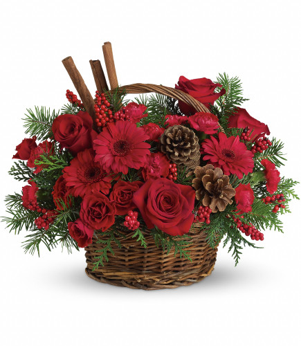 """Berries and Spice Gerbera Daisy Christmas Bouquet from Enchanted Florist. Festive red roses, red gerbera daisies, carnations and berries are arranged to look their holiday best when mixed with cinnamon sticks and pinecones in a lovely wicker basket. It's a great way to get a handle on your holiday gift list! Approximately 16"""" W x 13"""" H   SKU RM253"""