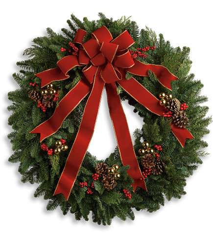 """Classic Holiday Fresh Christmas Wreath from Enchanted Florist Pasadena TX. A beautiful noble fir wreath with juniper branches, pinecones and berry sprays is adorned with a brilliantly festive red velvet bow. Anyone would be delighted to have this arrive on their doorstep! Approximately 25"""" W x 26"""" H.   SKU RM274"""