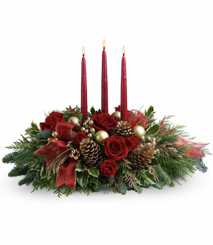 """All is Bright Christmas Centerpiece with 3 Candles from Enchanted Florist Pasadena TX. Large red roses and miniature red roses are artfully on display with merry touches like shimmery ornaments, pinecones, berries, organza ribbon and holiday greens. Three graceful red taper candles add the perfect magical touch. Approximately 25"""" W x 16"""" H SKU RM268"""