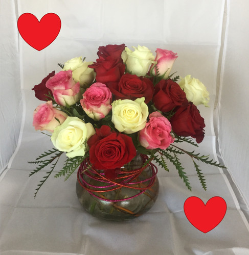 Valentines Love Bowl of Mixed Colored Roses by Enchanted Florist Pasadena TX. This exquisite bowl of 18 roses exudes happiness and love. A mixture of our premium roses in red, white and pink for a total of eighteen roses comes expertly arranged in our large Rosie Posie vase. The vase is adorned with hot pink and red glitter sticks for a little extra sparkle.  RM952