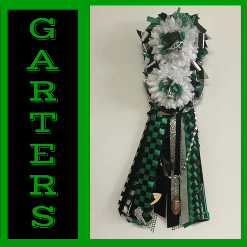 The Pasadena High School Homecoming Garter- Double Basic from Enchanted Florist includes a double flower, trinkets, metallic chain, the Military braid and garter band in the school colors of your choice.  HMC130