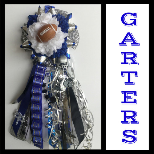 The Clear Springs Homecoming Garter from Enchanted Florist includes a single garter flower, trinkets, metallic chain, the Loopty braid and garter band in the school colors of your choice.  HMC132