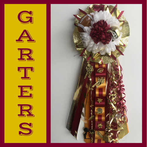 The Deer Park High School Homecoming Garter from Enchanted Florist includes a single garter flower, trinkets, metallic chain, the Loopty braid, and garter band in the school colors of your choice.  HMC140