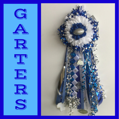 The Sam Rayburn High School Homecoming Garter from Enchanted Florist includes a single garter flower, trinkets, metallic chain, the Diamond braid and garter band in the school colors of your choice.  HMC145