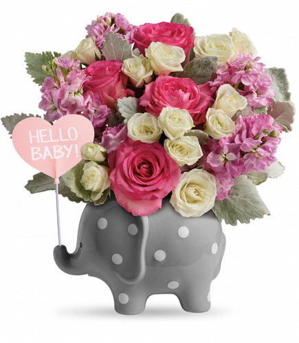 Hello Sweet Baby Girl Elephant with Flowers from Enchanted Florist. This adorable baby girl gift features pretty pink roses, white spray roses, pink stock, and various filler and greenery. Hand delivered in a Hello Baby Elephant keepsake container. RM 311
