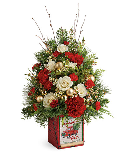 Vintage Greetings Tree hand delivered by Enchanted Florist. Festively arranged in a vintage-inspired metal keepsake cube, this jolly tree of red blooms, fresh greens and shimmering ornaments is a Christmas surprise they will never forget! SKU T19X610