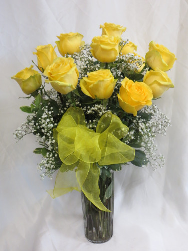 "Sunny Dozen Yellow Roses by Enchanted Florist Pasadena TX - One dozen long stems yellow roses are arranged in a vase with baby's breath and ribbons as pictured. Don't make you special someone design her own flowers from a box! Our beautiful Ecuadorean roses are hand designed by expert floral artisans. Yellow is the color of friendship!  Dozen Roses is approximately 18""W x 22""H   SKU RM372"