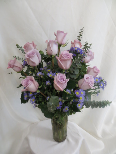 "Twilight One Dozen Purple Roses by Enchanted Florist Pasadena TX - One dozen long stems purple roses are arranged in a vase. Don't make you special someone design her own flowers from a box! Our beautiful Ecuadorean roses are hand designed by expert floral artisans. Purple rose bouquet is approximately 18""W x 22""H   SKU RM374"