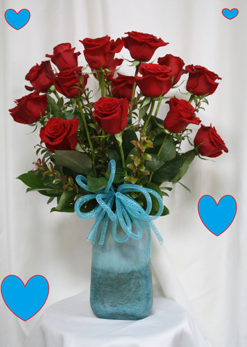"""Love Song Red Roses with Turquoise Vase for Valentines Day by Enchanted Florist Pasadena TX. Sing out your love to your sweetheart this Valentine's Day with romantic red roses expertly designed in this keepsake turquoise vase.  Size is approximately 24"""" H x 16"""" W   RM965"""