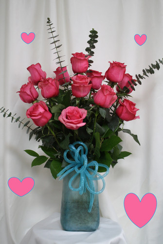 """Melody Hot Pink Roses with Turquoise Vase for Valentines Day by Enchanted Florist TX. Sing out your love to your sweetheart this Valentine's Day with romantic hot pink roses expertly designed in this keepsake turquoise vase.  Size is approximately 26""""H x 16""""W   RM961"""