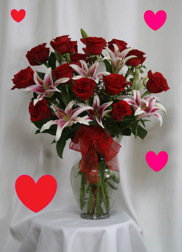 """Lots of Love Red Roses and Stargazers for Valentines Day by Enchanted Florist TX. Our two most popular flower requests teamed up together to make this stunning and romantic display of love and affection for your sweetheart.  Size is approximately 25""""H x 17""""W   RM962"""