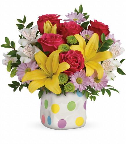 Delightful Dots of Flowers from Enchanted Florist. This delightful mix includes pink roses, yellow Asiatic lilies, white alstroemeria, green button spray chrysanthemums, lavender daisy spray chrysanthemums and various greenery. Hand delivered by our professionals in the exclusive Happy Dots cube. SKU RM176