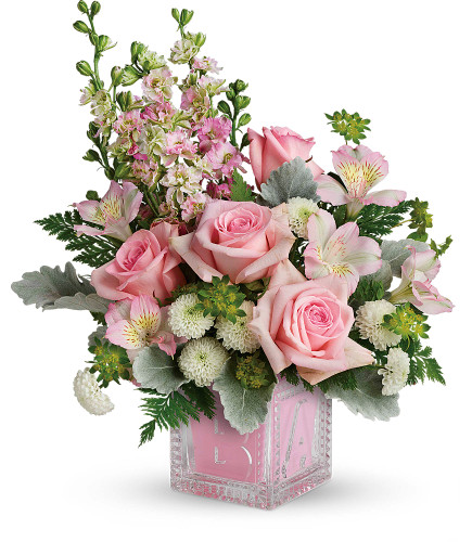 Welcome Baby Girl Crystal Block Arrangement by Enchanted Florist. This baby boy crystal block arrangement includes pink roses, pink alstroemeria, white button mums, and pink larkspur and are arranged with various fillers and assorted greenery. Hand delivered in our exclusive baby girl crystal block. RM309