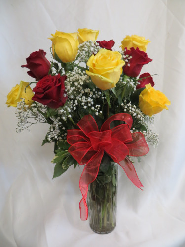 "One Dozen Red and Yellow Roses with Baby's Breath by Enchanted Florist - One dozen long stems red and yellow roses are arranged in a vase with baby's breath and ribbons as pictured. A beautiful combination for your lucky someone special. Approximately 18""W x 22""H   SKU RM376"