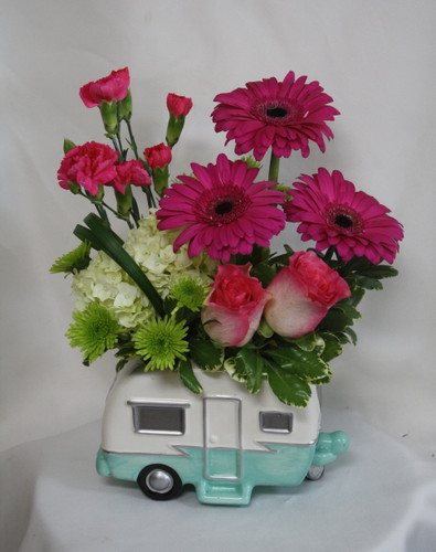 """Vintage Camping Trailer in Pink from Enchanted Florist. A fun way to celebrate any occasion. A perfect gift for those that love anything vintage or the avid camper in your life. Flowers include hot pink gerbera daisies, pink roses, pink pixie carnations, green hydrangeas and green button poms and arrive in this adorable keepsake vintage trailer. Approximately 13""""H x 11""""W SKU RM186"""
